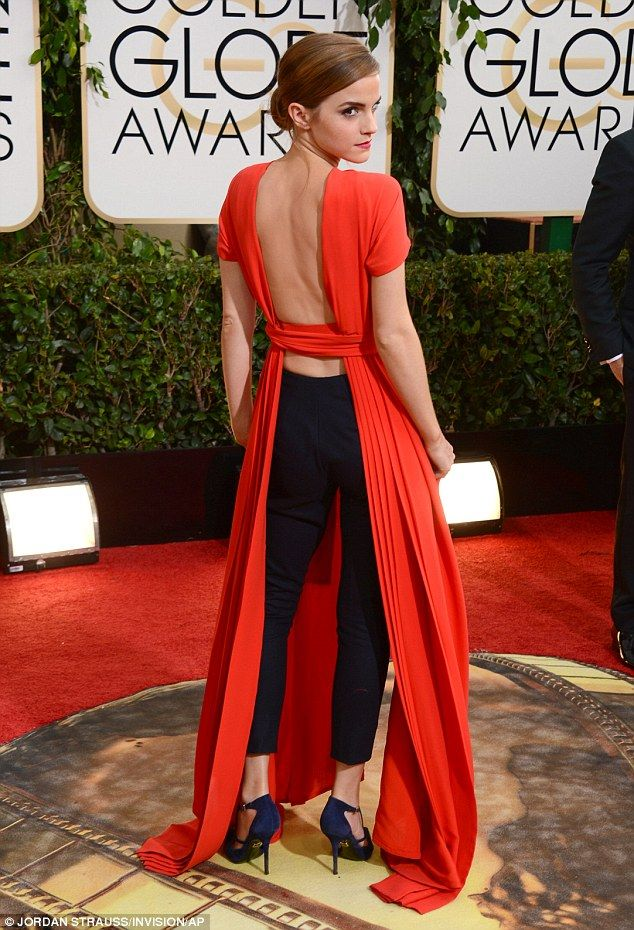 Leggings: The 23-year-old showed off her bare back and black pants underneath her orange gown