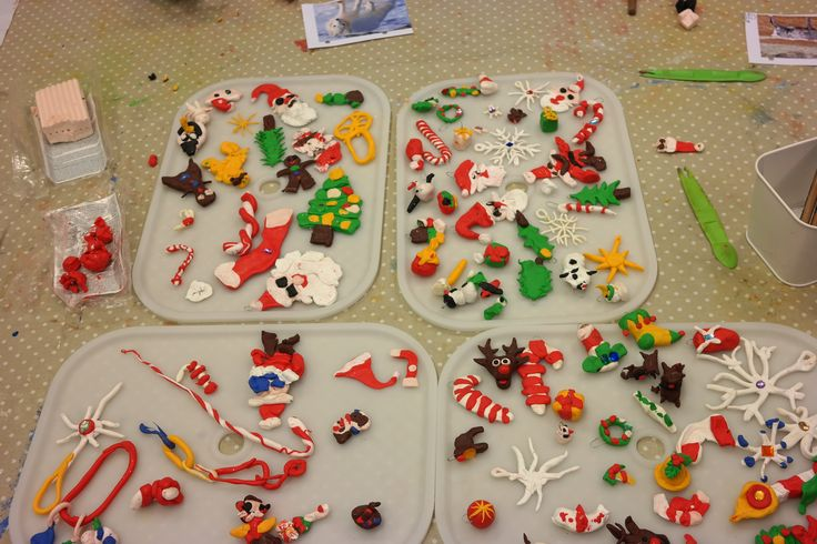 All of our class's fimo clay ornaments! They had pictures to  model their ornaments after and the teachers also sat and made their own to show how to do it. I was very surprised by how well they did!