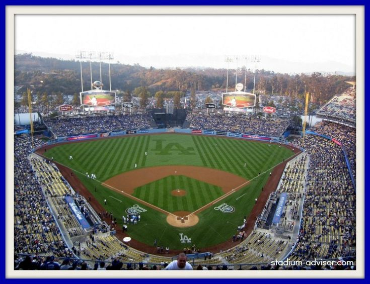 Dodger Stadium located in Chavez Ravine near downtown Los Angeles. The San Gabriel Mountains are ...