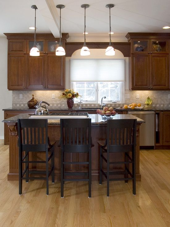 Spaces kitchens with cherry wood cabinets design pictures for Traditional kitchen lighting ideas