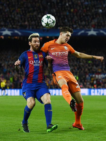 Lionel Messi of Barcelona holds off pressure from John Stones of Manchester City during the UEFA Champions League group C match between FC Barcelona and Manchester City FC at Camp Nou on October 19, 2016 in Barcelona, Catalonia.