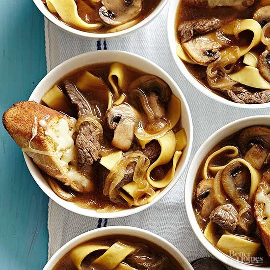 Make French onion soup a meal by adding slices of sirloin steak, plenty of meaty mushrooms, and a handful of egg noodles. For a traditional touch, this caramelized onion soup is still topped with a cheesy toast.