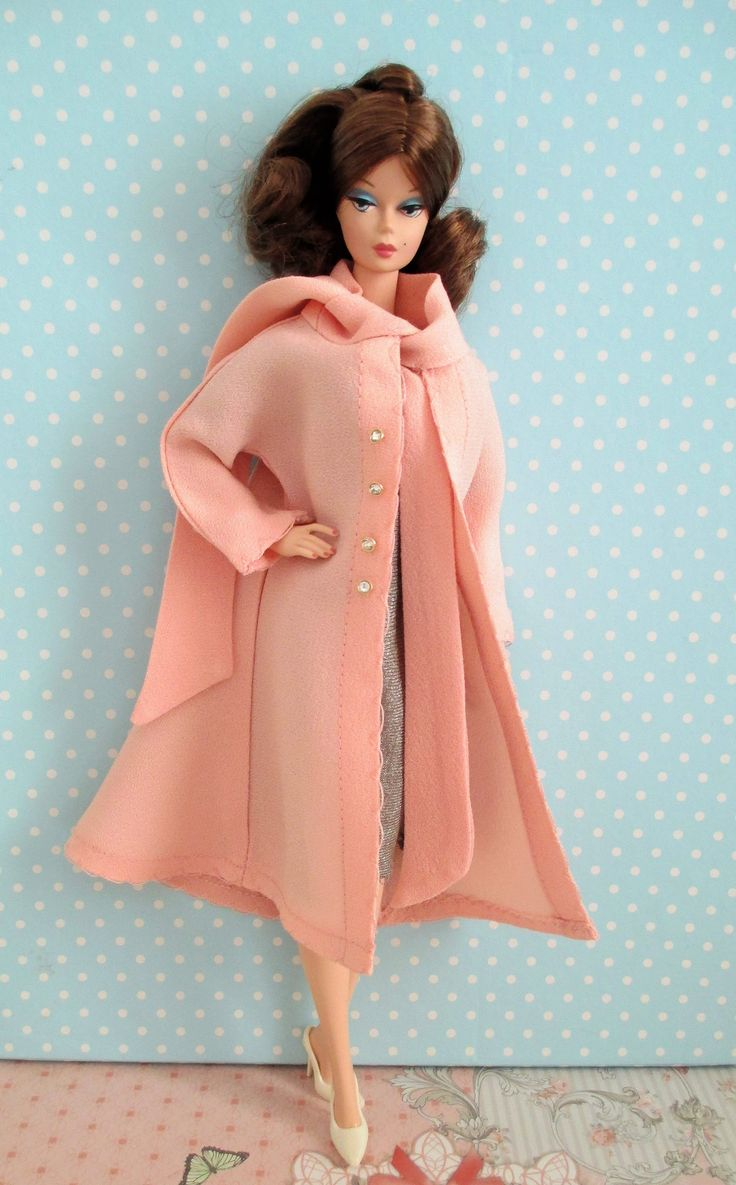 Up for sale is a handmade by me overcoat and dress for Silkstone Barbie, Sindy Pedigree and Bibi-bo. Both overcoat and dress can fit other Barbie dolls, mostly those with the classic body. For Barbie Fashionistas will be a little big.  The overcoat is made of pink french crepe cloth with the addition of tiny miniature gold color buttons with white crystals. The dress is made of fine lamé jersey cloth with the addition of a small bow.  Please notice that the sale is for the overcoat and dress…