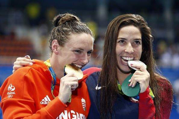 Hungary's Katinka Hosszu and USA's Madeline 'Maya' Dirado pose on the podium after they respectively won gold and silver in the Women's 400m...