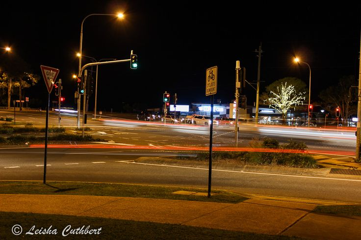 L2M2AS2 - Part C - Blurred movement - M Mode - Canon 600D - Shutter Speed 1.3 - ISO 100 - Aperture f/4.5 - Exposure Bias 0 step - Focal length 29mm - Tripod  - Positioned on the corner of an intersection, I was able to capture the blurred movement of vehicles passing in various directions under street lights.