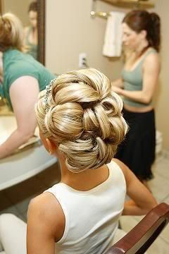 Big circles of hair... looks fab while up with veil and then later in the night when you take it down it has the gorgeous 50's Hollywood waves in it!