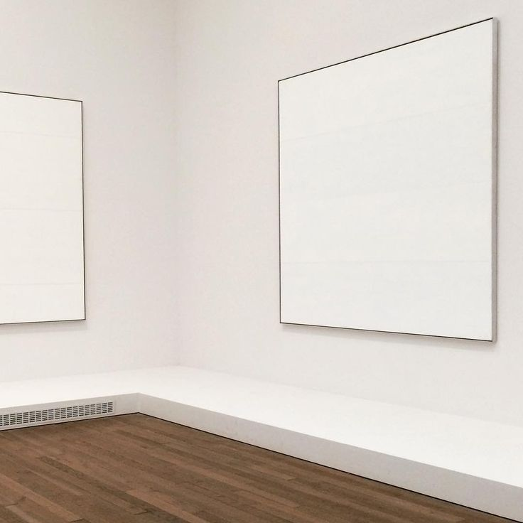 Agnes Martin - The Islands, 1979. A series of twelve large square white acrylic and graphite paintings. Martin specified they should always be shown together, here they are in Room 9 at Tate Modern - image timeandtoast