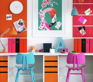 Brightly-colored home office space with flamingo print on wall
