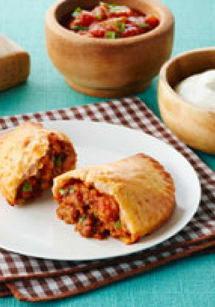 Tex-Mex Mini Turnover Appetizers – A quick and easy dough made with cream cheese, flour and butter makes a delicious envelope for these Tex Mex-inspired ground beef turnover appetizers.