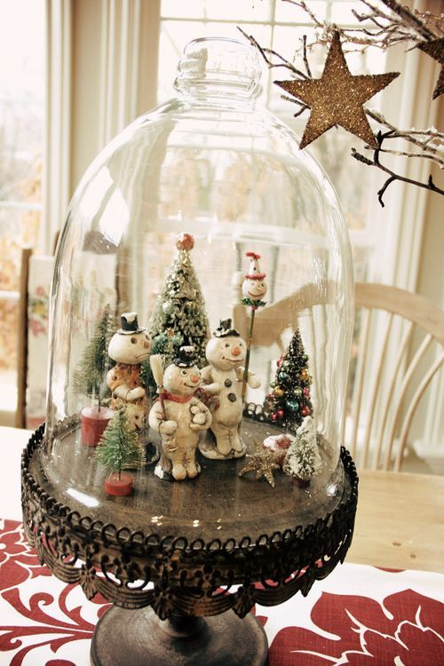 Snowmen gathering under the cloche