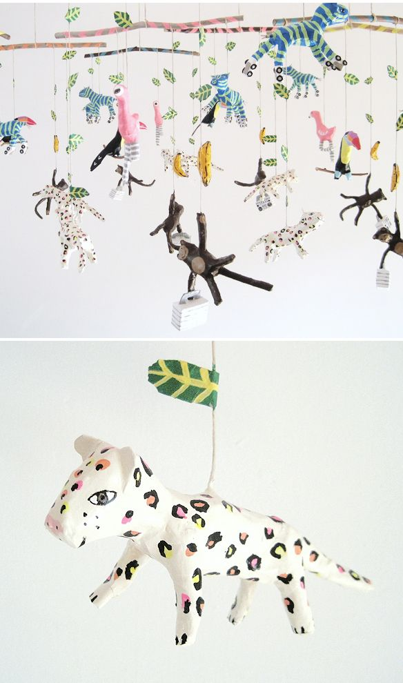 these mobiles are awesome! (monkeys with luggage! flamingoes with stripy socks! Neon zebras on roller-skates!) the kid in me is bouncing up and down.