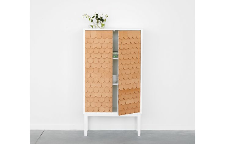 Collect 2012 Cabinet by A2 Designers  Collect 2012 is a distinct little cabinet for your favourite things designed by Sara Larsson. It is far away from any anonymous storage system and is characterised by its beautiful doors in leather. Collect 2012 is a limited edition of 81 cabinets. The cabinet has a fish scale patterned front made in Tärnsjö leather and comes with a signed and numbered metal plate.