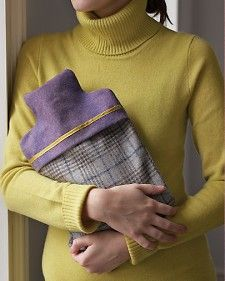 Whether it's chilly inside or out, a hot-water bottle slipped into a soft cloth cover is a classic comfort.