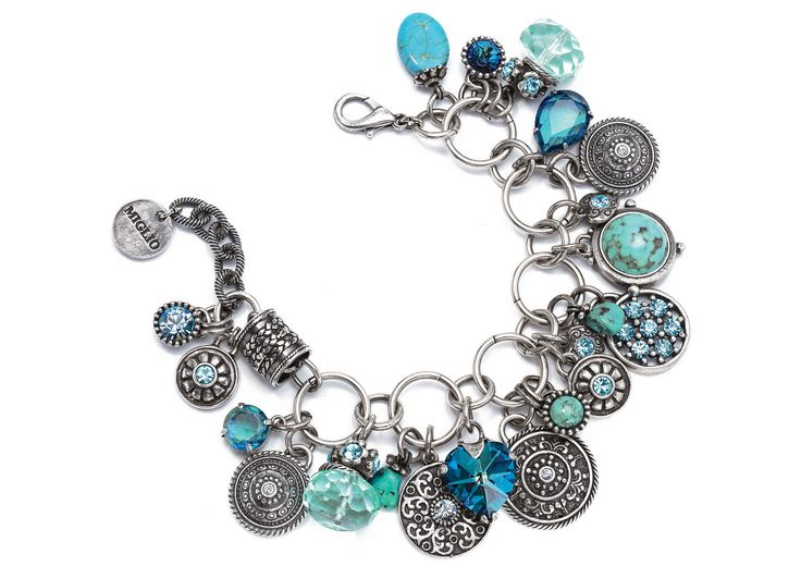 B891 - Our exquisite multi-link charm bracelet featuring a kaleidoscope of vibrant blue Swarovski crystals set in burnished silver charms, coupled with multifaceted crystals and marbled turquoise stones.   Length: 19 cm plus extender