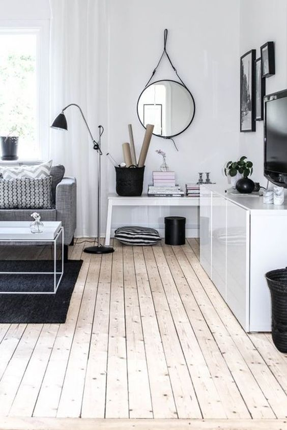 Using a soft grey and white colour palette for a stylish living room never goes out of fashion. Couple with stripped floorboards and you have the ultimate modern space to relax in.