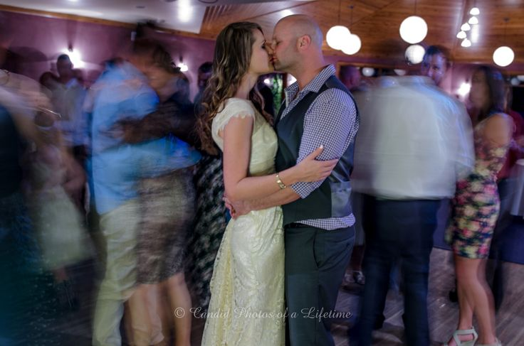 Wedding photographer, Candid Photos of a Lifetime  the bride & groom enjoyed their 1st dance so much that they didn't even notice others joining them on the dance floor
