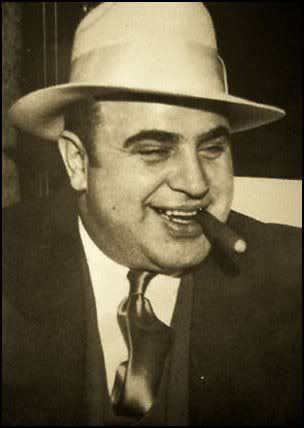"Alphonse Gabriel ""Al"" Capone (January 17, 1899 - January 25, 1947), commonly nicknamed Scarface, was an Italian American gangster who led a crime syndicate dedicated to the smuggling and bootlegging of liquor and other illegal activities during the Prohibition Era of the 1920s and 1930s in Chicago. Eventually thrown in prison for...Tax Evasion, go figure."