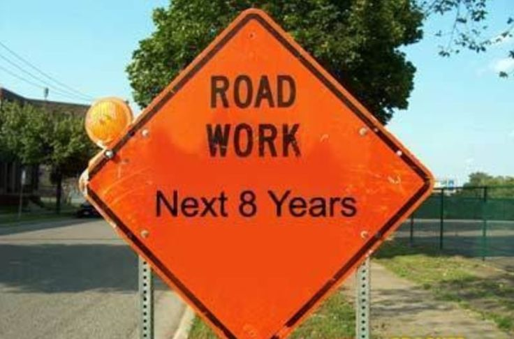 This must be a really old sign. ROAD WORK is never finished!
