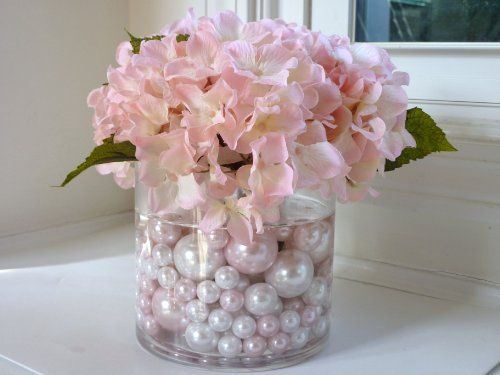 Inexpensive idea for a wedding  table decoration. Pearls on bottom with flowers on top. Tea candles on mirrors