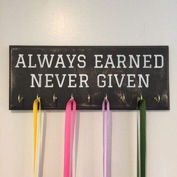 "A rustic and distressed style medal holder which features the powerful saying ""Always Earned, Never Given."" This Medal Rack is perfect for runners or any athlete. Makes a great running medal holder."