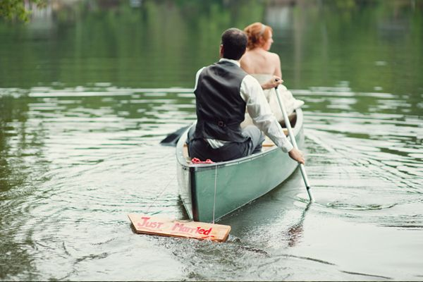 A summer wedding by a lake and a charming exit by canoe