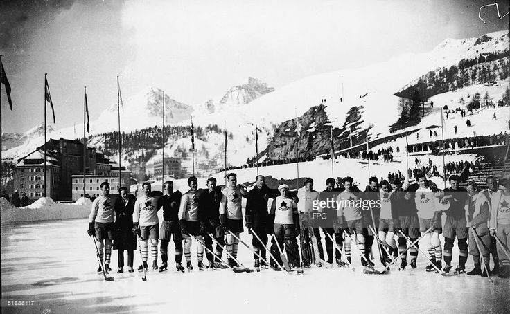 Members of the Canadian and Swedish Olympic hockey teams line up on an outdoor ice rink after the 1928 Winter Olympic Games, where the Canadian team won the gold medal and the Swedish team won the silver in the event final on February 19, St. Moritz, Switzerland, February 27, 1928. The Swiss Alps are in the background. (Photo by FPG/Getty Images)