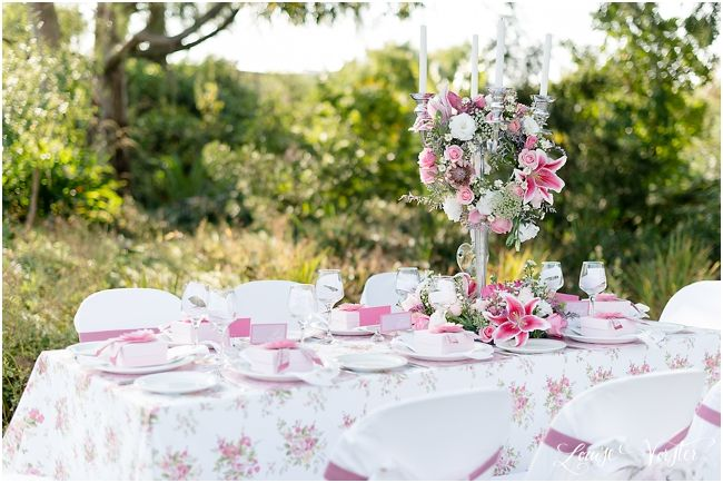 A complete view of pink table seeing the center piece