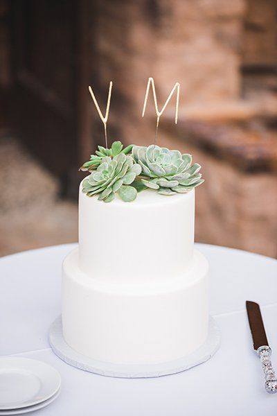 If you're throwing a modern-themed wedding, consider this succulent-topped stunner. Initials add the perfect finishing touch.