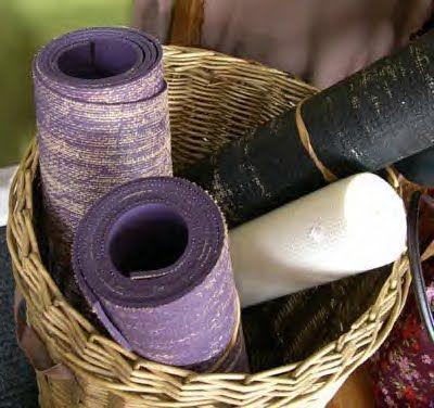 yoga mats in a wicker basket