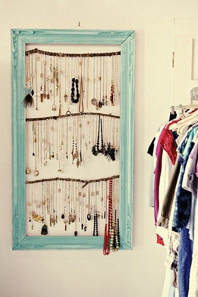 use an old picture frame, some wooden dowels and eye hooks from Hardware Hank, and you've got a jewelry organizer!