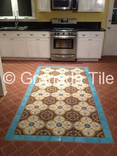 A cement tile carpet (in our Normandy concrete tile design) in a Los Angeles–area kitchen adds a vibrant dash of pattern and color to the space. Tile photo, Granada Tile.