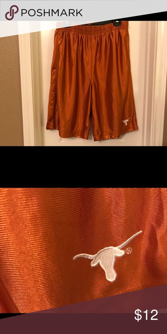 UT Texas Longhorns Athletic Shorts Size Large VGC UT University of Texas Longhorns Athletic Shorts Size Large. They are in very good condition--no holes, rips or stains. There are a few small spots of pilling on the back but nothing really noticeable--still lots of life left. There is an inside drawstring and side pockets. Color is  burnt orange with an embroidered longhorn on the bottom of the left leg. Material is 100% polyester. Smoke-free home. ProEdge Shorts Athletic