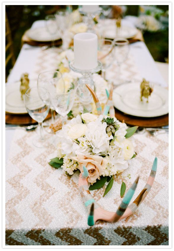 Colorblock pastel painted antlers + a sequined chevron tablecloth = rustic glam to a tee!