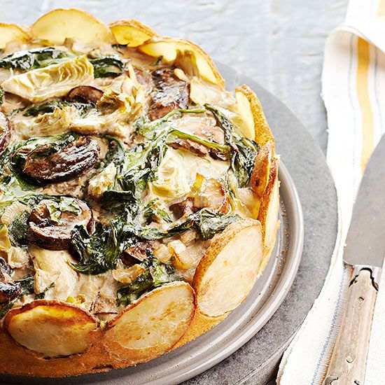 This springform torte's cheesy spinach, mushroom, and artichoke filling is just as delicious as itsfancy exterior. The tall edges of your springform pan keep the crust's potatoes standing at attention.