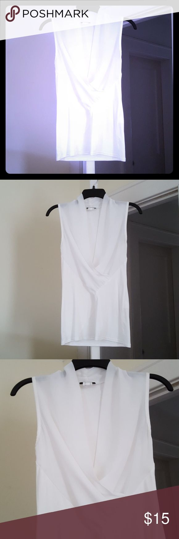 Venus sleeveless surplice top Beautiful lightweight white surplice top is soft and slightly sheer up top. I ordered this and never wore it so it's in perfect condition. Simple yet stunning. Venus Tops Blouses