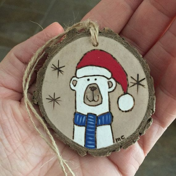 Wood slice polar bear Christmas ornament, hand painted and wood burned onto a pretty wood slice. Personalized on the back. Please let me know in the note to seller section during check out what wording you would like added. Why not buy two? During check out, you have the option to buy 2 for a discounted price! Plus you save big on shipping. Yay!  All of my wood burnings originate from a free hand drawing in pencil. With a wood burner I outlined the drawing and filled it in with acrylic…