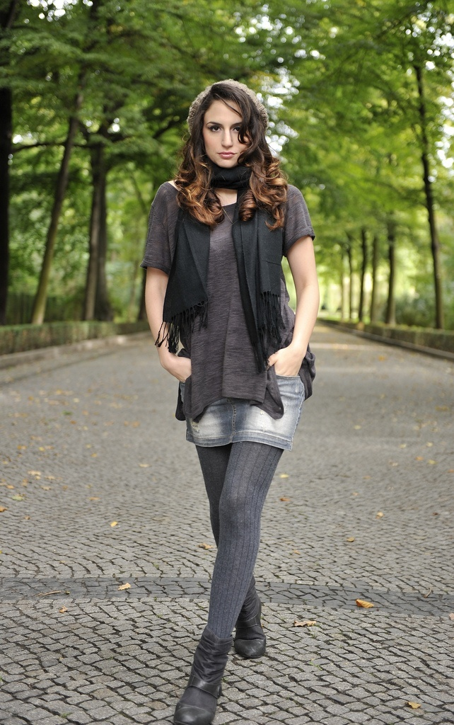 Grey ribbed wool tights with grey denim skirt.  T-shirt top in grey, black neck scarf & a hat.  Ankle boots finish the look.