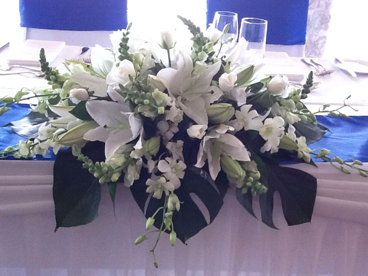 Traditional white bridal table arrangement by www.newminsterfunctiondesign.com