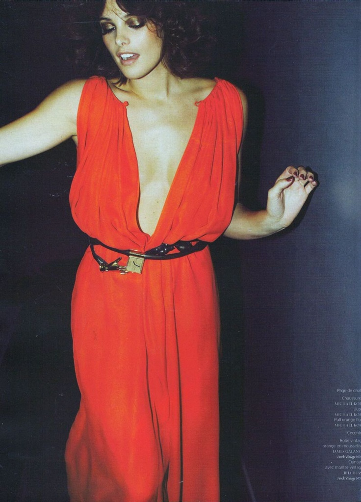 Scarlet red silk glamour in the seventies. Click to shop silk gowns by Matthew Williamson.