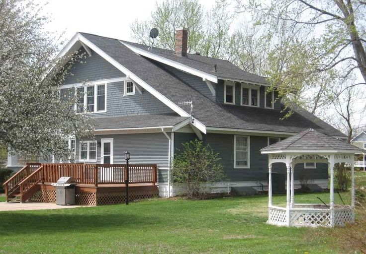 Classic Craftsman construction featuring: - Wide eaves with exposed rafter tails - Shed dormers...