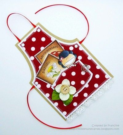 Beautiful apron card with a great tutorial: I like the layering, the fabric must give it a nice texture and all the details like the seed cards inside the pocket and the flower in a corner, it´s a very well balanced placing of the elements. Love it!