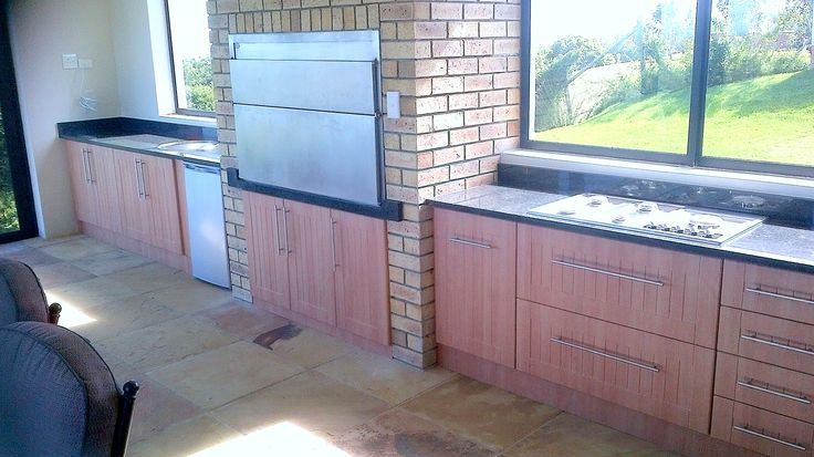 Dimension Cabinets - Indoor braai area with cupboard and drawer space in Memphis Cherry melamine and Rustenburg granite tops.