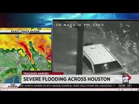 Live TV coverage spots vehicle stuck in fast moving flood waters from traffic camera, person rescued - YouTube