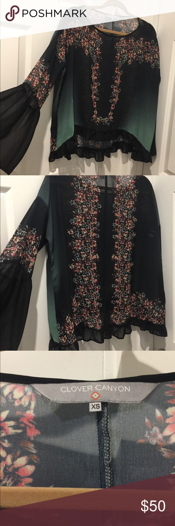 Clover Canyon Ruffle Top Chiffon Clover Canyon top with ruffle hem and bell sleeves. Loose, drapey fit. Size XS. 100% polyester. Good condition. Clover Canyon Tops Blouses
