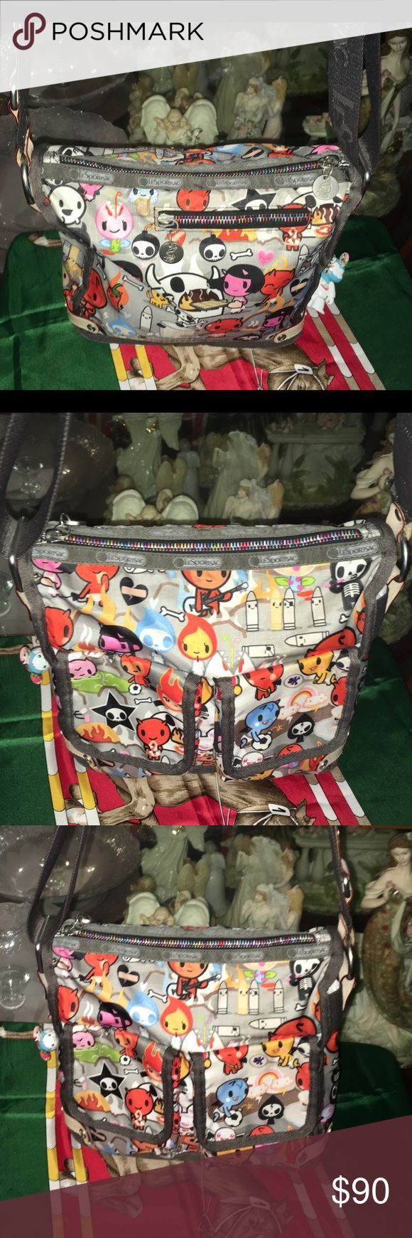 Lesportsac Tokidoki Inferno Crossbody Bag Here is a Lesportsac Tokidoki Inferno Crossbody Bag. It is in like new condition. It is 10 inches wide and 9 inches tall Tokidoki Bags Crossbody Bags