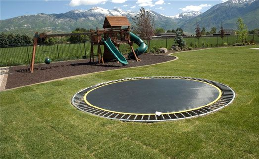 Ground-level trampoline - it just has to be a little safer than a raised unit...