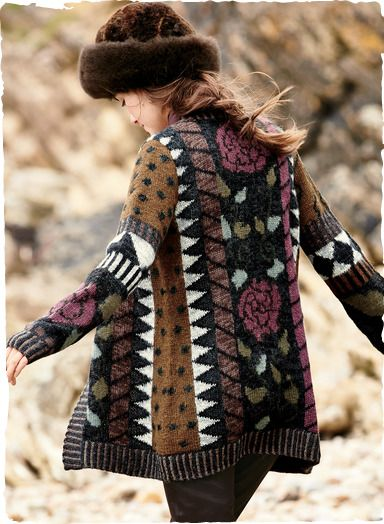 Our collectible art knit is a rich pastiche of tribal geometrics and full-blown roses. Handloomed in soft, snuggly alpaca (85%) and wool (15%) and framed in a striped rib.