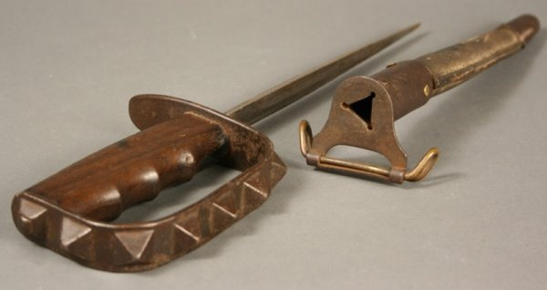 1917 Trench Knife. Later deemed inhumane because the wounds caused by the triangular blade were not easy to close by the field medics, thus resulting in infections in the wounds.
