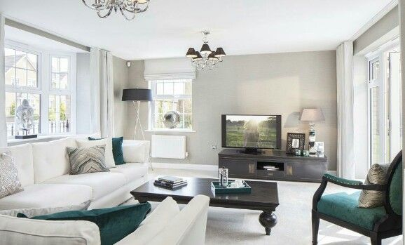 interior designed living room david wilson homes 2015 chalk white teal accents and