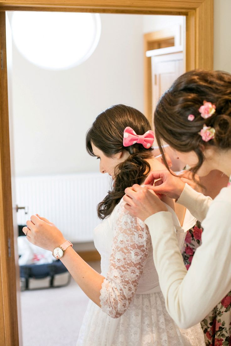 Bride wears a pink polka dot hair bow | Photography by http://www.annelimarinovich.com/